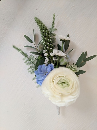 White Garden Boutonniere with Blue Accents